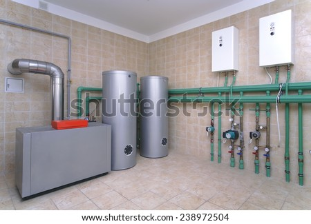 Boiler room with a heating system in a private house - stock photo