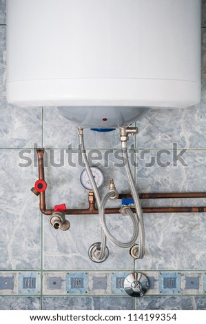 Boiler with gauge and copper heating pipes - stock photo