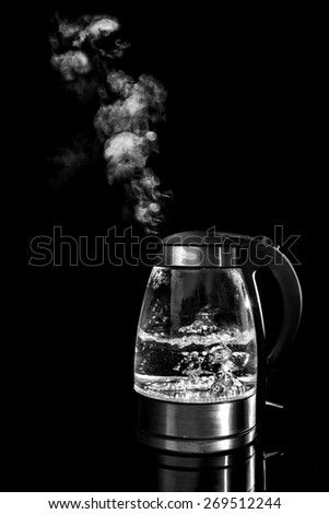 Boiling kettle in black and white - stock photo