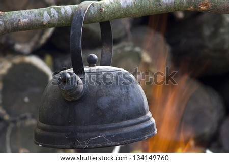 boiling kettle on the fire - stock photo
