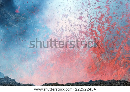 Boiling lava and volcanic bombs in a breakthrough on the slopes of the crater of the volcano cone Tolbachik - Kamchatka, Russia - stock photo