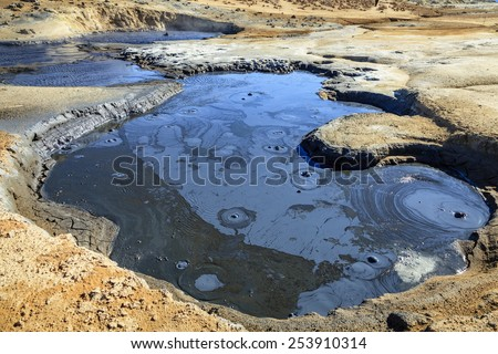 Boiling mud pool in Hverir - geothermal field in Northern Iceland - stock photo