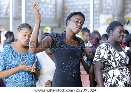 BOIS NEUS, HAITI - FEBRUARY 9, 2014:  Unidentified worshipers  in a Christian church in Bois Neus, Haiti.   - stock photo