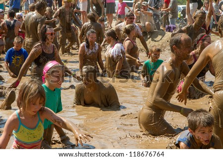 BOISE, IDAHO - AUGUST 25: Crowd gathered in the mud pit at the Dirty Dash August 25 2012 in Boise, Idaho - stock photo