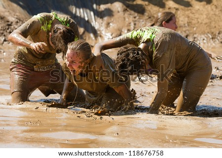 BOISE, IDAHO - AUGUST 25: Group of people horsing around in the mud at the Dirty Dash August 25 2012 in Boise, Idaho - stock photo