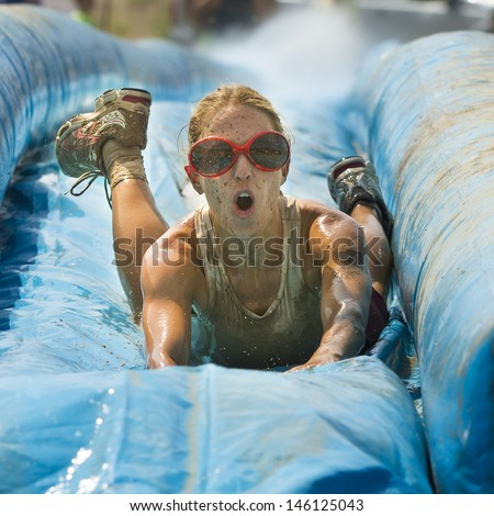 BOISE/IDAHO - AUGUST 25: Head on view of a runner taking on the slide during The Dirty Dash in Boise, Idaho on August 25, 2012