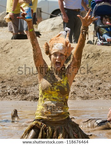BOISE, IDAHO - AUGUST 25: Runner 14959 is excited at completing the Dirty Dash August 25 2012 in Boise, Idaho - stock photo