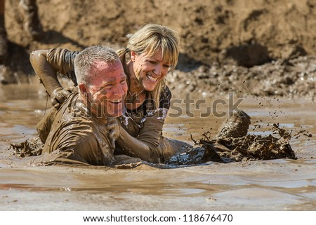 BOISE, IDAHO - AUGUST 25: Runners at the Dirty Dash splash in the mud on August 25 2012 in Boise, Idaho - stock photo