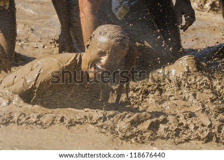 BOISE, IDAHO - AUGUST 25: Unidentified person gets sprayed with water at the Dirty Dash August 25 2012 in Boise, Idaho - stock photo