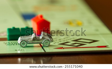 BOISE, IDAHO - NOVEMBER 18, 2012: Car from the game Monopoly speeding past. Game was made by Parker Brothers now owned by Hasbro - stock photo