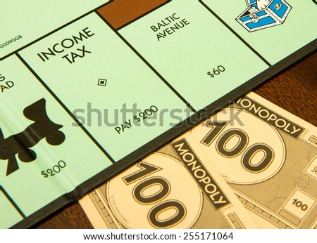 BOISE, IDAHO - NOVEMBER 18, 2012: Income tax time if you land on this spot for the game Monopoly made by Hasbro - stock photo