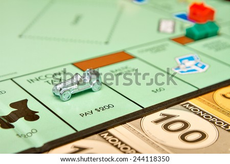 BOISE, IDAHO - NOVEMBER 18, 2012: The game Monopoly has been published by Parker Brothers since 1935 - stock photo