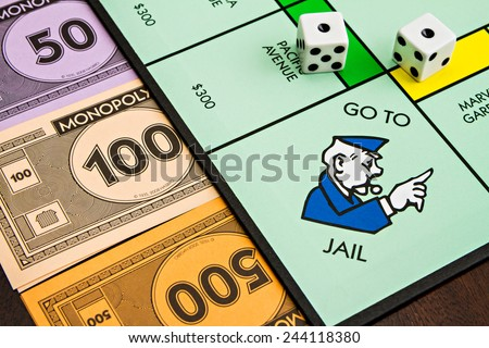 BOISE, IDAHO - NOVEMBER 18, 2012: The monopoly board game was first published by Parker Brothers, currently owned by Hasbro, in 1935  - stock photo