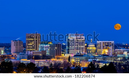 Boise Idaho skyline at night with moon - stock photo