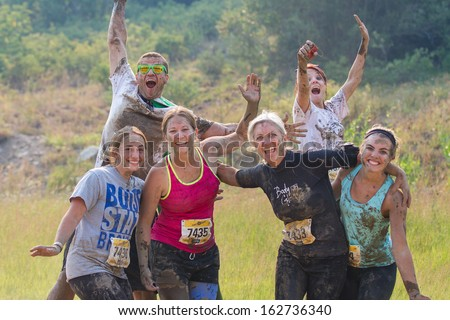 BOISE, IDAHO/USA - AUGUST 10: Group of people pose during the race at the The Dirty Dash in Boise, Idaho on August 10, 2013  - stock photo