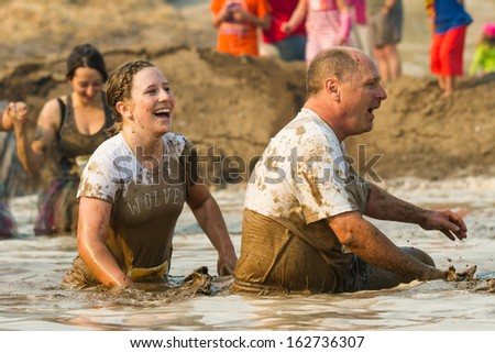 BOISE, IDAHO/USA - AUGUST 10: Two unidentified people make their way through the mud pit at the The Dirty Dash in Boise, Idaho on August 10, 2013