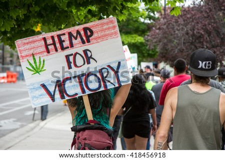 BOISE, IDAHO/USA - MAY 7, 2016: Displaying a Hemp for Victory sign a woman marches to the capital during the Global Marijuana March in Boise - stock photo