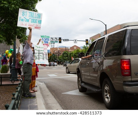 BOISE, IDAHO/USA - MAY 7, 2016: People during the Boise Global Marijuana March trying to get their message to make pot legal to other drivers in Boise, Idaho