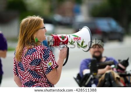 BOISE, IDAHO/USA - MAY 7, 2016: Telling her story about marijuana a woman talks during the Boise Global Marijuana rally in Boise, Idaho - stock photo