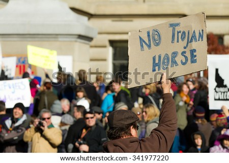 BOISE, IDAHO/USA - NOVEMBER 21, 2015: Guy against the recent syrian refugees protesting in Boise, Idaho - stock photo