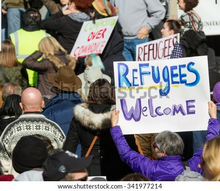 BOISE, IDAHO/USA - NOVEMBER 21, 2015: Idaho resident welcoming refugees with her sign in Boise, Idaho - stock photo