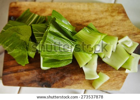 bok choy cut on the cutting board - stock photo