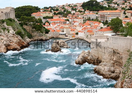 Bokar Tower of Dubrovnik and its harbor, with the old town in the background - stock photo