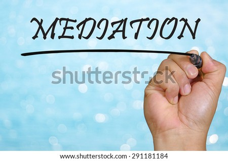 bokeh background and hand writing mediation. - stock photo