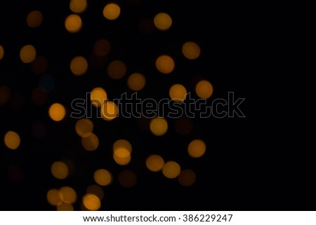 Bokeh. Background. Highlights. Defocused light isolated in black background.