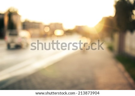 Bokeh background, street, road, sun - stock photo