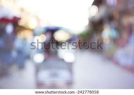 Bokeh background, street, road, sun , Street in chiang khan city in bokeh. Defocused background. - stock photo