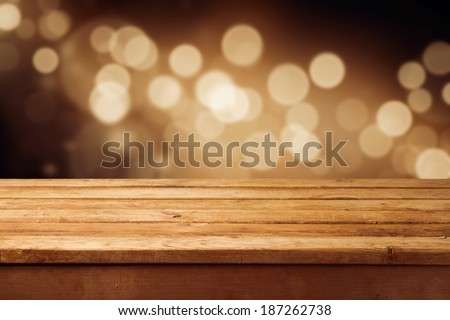 Bokeh background with empty wooden deck table for product montage display - stock photo
