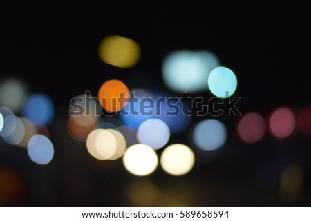 Bokeh blurred car lights at the evening.