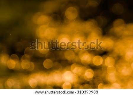 bokeh blurry natural abstract yellow gold background - stock photo