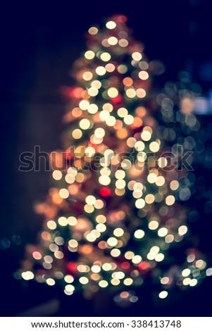 bokeh christmas tree lighting background with vintage color tone - Vintage Christmas Tree Lights