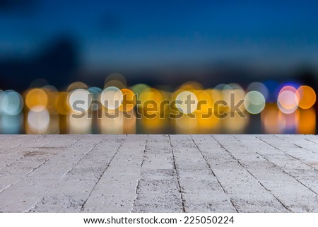 bokeh elegant abstract background with bokeh lights and cement floor - stock photo