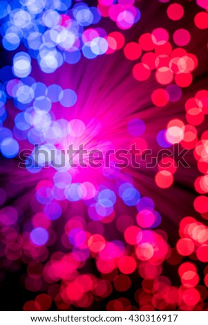 Bokeh from defocussed red and blue lights from a fibre optic lamp