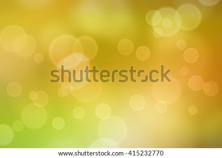Bokeh light circles applied to yellow blurred background