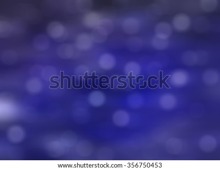 Bokeh light, shimmering blur spot lights on blue abstract background.