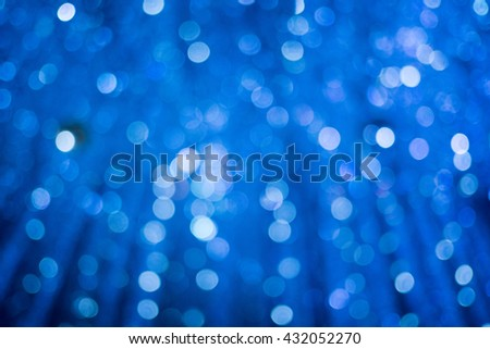 Bokeh light, shimmering blur spot lights on blue abstract background