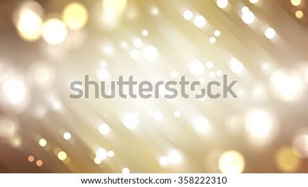 Bokeh light, shimmering blur spot lights on gold abstract background. - stock photo