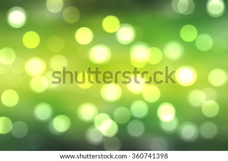 Bokeh light, shimmering blur spot lights on green abstract background.