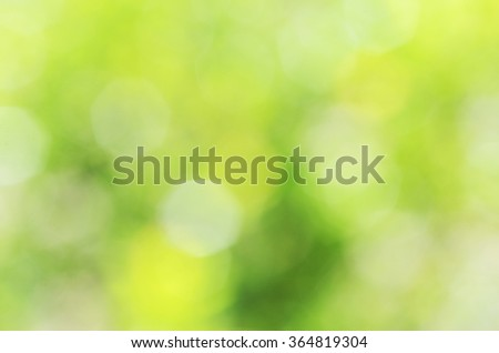 bokeh light yellow green abstract backgrounds textures - stock photo