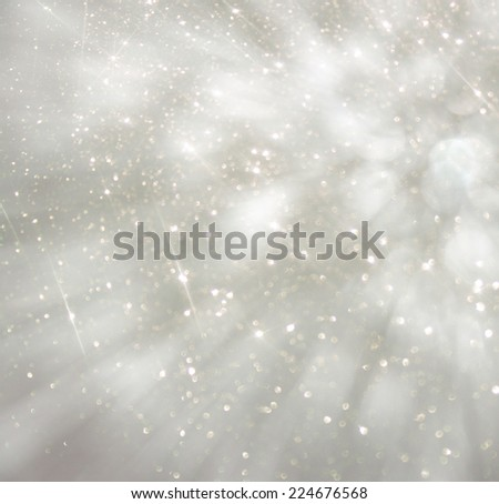 bokeh lights background with colors of white and silver and motion blur  - stock photo
