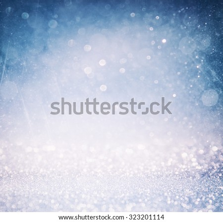 bokeh lights background with multi layers and colors of white silver and blue  - stock photo