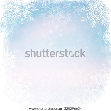 bokeh lights background with multi layers and colors of white silver and blue with snowflakes overlay  - stock photo