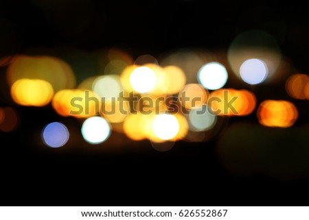 Bokeh multi-colored lights fly on a dark background