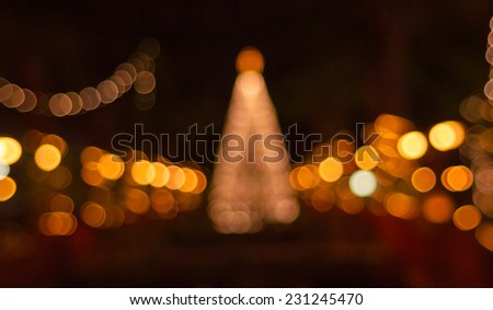 Bokeh of big christmas light tree  - stock photo
