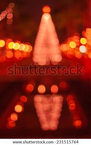 Bokeh of big christmas light tree  - stock photo