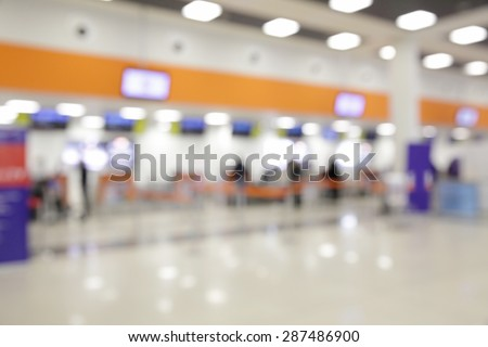 Bokeh of check-in counters in airport - defocused background - stock photo